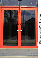 Door glass. - The door tinted glass with a bright pink frame...