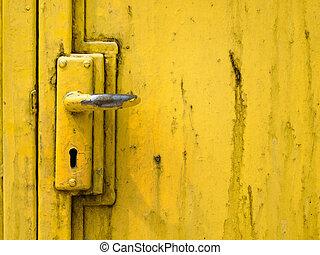 Door handle and steel door painted yellow