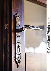 Door handle - Detail of an old engraved door handle