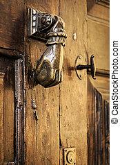 Door handle knocker close up