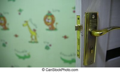 Close-up elements of the interior of the apartment. Detail of a white interior door with a door handle and latch . White door Golden handle