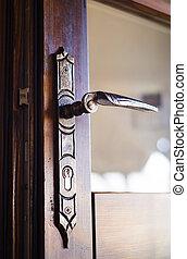Door handle - Detail of an old engraved door handle
