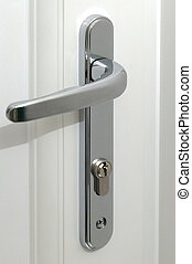 Door Handle - a chrome door handle with key hole on a white...
