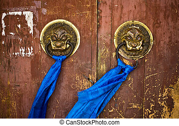 Door handles on ancient temple - Ornate door handles and...