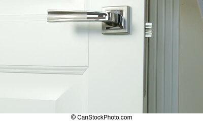 Door hanger Do Not Disturb with hearts on handle of hotel room