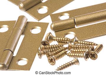 Isolated macro image of door hinges and screws.