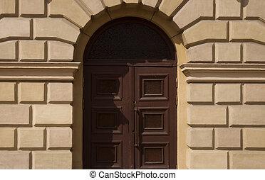 Door in a city building - Facade of a city building. City ...