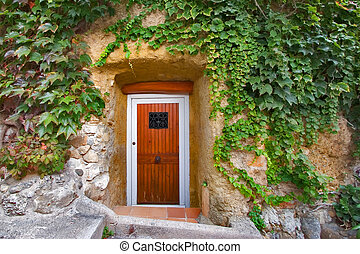 Door in a wall. - A door in the ancient stone house in a...