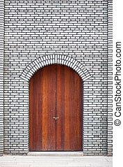 door in brick wall