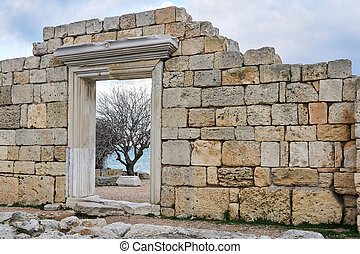 door in the ruins of antique temple by the sea schore