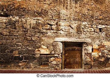 Door in the stone wall.