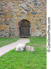 Door in to a stone wall