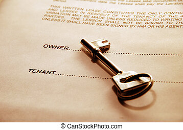 door key on rental agreement - key lying on a lease document