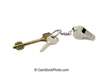 keys and whistle - door keys and whistle as trinket on white
