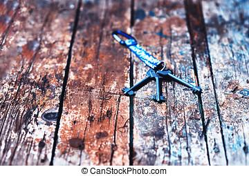 Door keys on vintage wooden table bokeh background hd