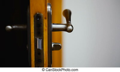 Door knob. Yellow door with door handle