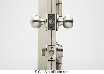 Door knobs, aluminum door white background.