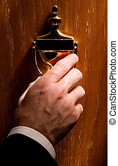 Door Knocker - Door knocker with businessman's hand. Place ...