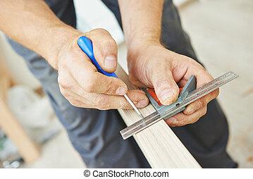 door lock installation - Close-up carpenter process of wood...