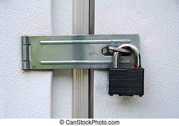 Door locked with a padlock - A door locked with a padlock
