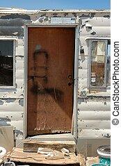 Door of a squalid trailer