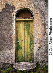 door of old abandoned cottage