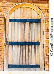 Door on brick wall
