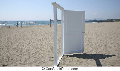 Door on the beach, opened to a view of coast