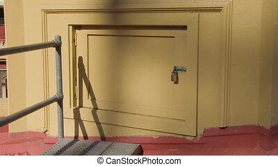 Door on top of a roof - A medium shot of a door on top of a...