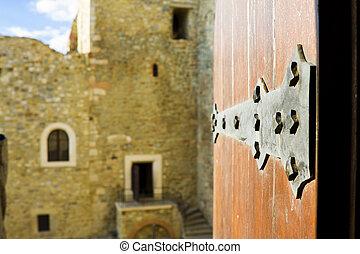 Door open in an old castle