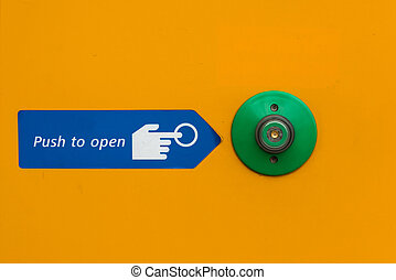 Door open push button in green with instructions to open