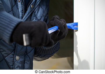Door opening closeup - A close up of a burglar trying to...