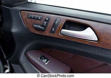 Door panel with power window controller. Detail of the car interior