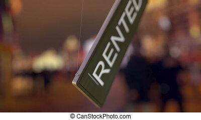 Door sign is turned over from FOR RENT to RENTED - Door sign...