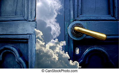 Open old blue door to sky with clouds maby the way to haven