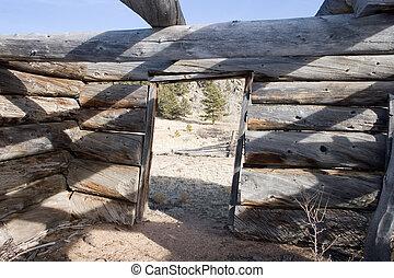door to log cabin - View of the doorway of a fallen down log...