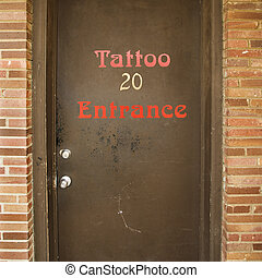 Door to tattoo parlor. - Doorway entrance to tattoo parlor.