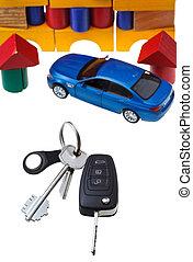 door, vehicle keys, blue car model and block house