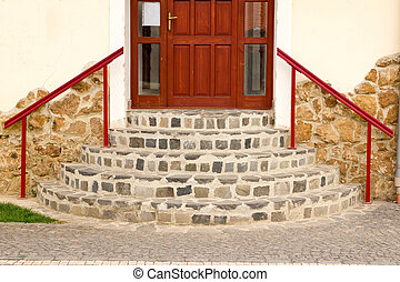 Door with a round staircase