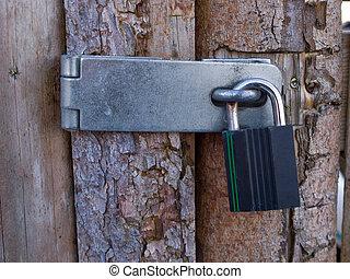 Door with heavy lock padlock