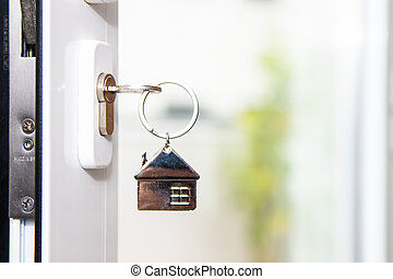 door with key in the lock open to the outside