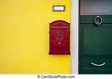 Door with red letterbox - A red letterbox on a yellow...