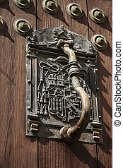 Doorknocker with coats of arms, Caceres, Spain