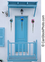 Doors and walls white blue awning.