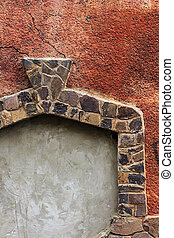 doorway frame of stone on red cracked texture - immured...