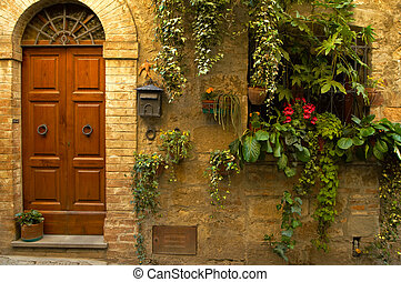 Doorway garden, Italian village - Walls and flowers in...