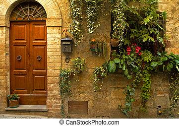 Doorway garden, Italian village - Walls and flowers in...
