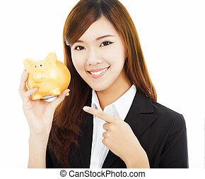 doré, femme affaires, asiatique, tenue, banque, porcin