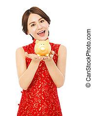 doré, femme, chinois, jeune, porcin, tenue, année, nouveau, banque, heureux