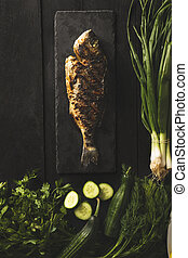 Dorado fish cooked with cucumbers, fresh onions, parcel and dill